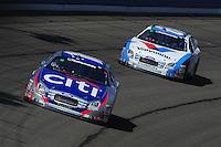 Oct. 10, 2009; Fontana, CA, USA; NASCAR Nationwide Series driver Greg Biffle leads Carl Edwards during the Copart 300 at Auto Club Speedway. Mandatory Credit: Mark J. Rebilas-