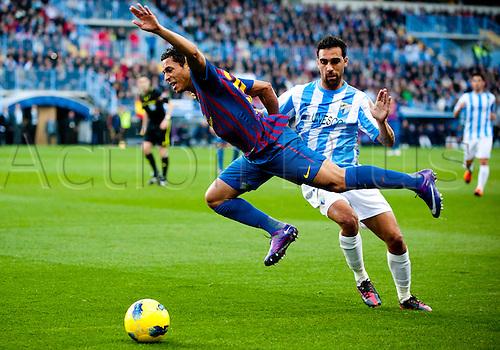 22.01.2012 Malaga, Spain. The La Liga football match between FC Malaga and FC Barcelona played in the La Rosaleda Stadium. Image shows, Adriano Correia from Brazil (FC Barcelona) Jesus Gamez (Malaga CF)..