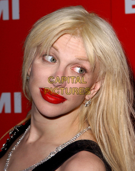 COURTNEY LOVE.EMI Post Grammy Party held at The Los Angeles County Museum of Art in Los Angeles, California .8 February 2004                                                                      *UK Sales Only*.portrait, headshot, bad make-up, red lipstick, look closer, bleeding lipstick.www.capitalpictures.com.sales@capitalpictures.com.©Capital Pictures.