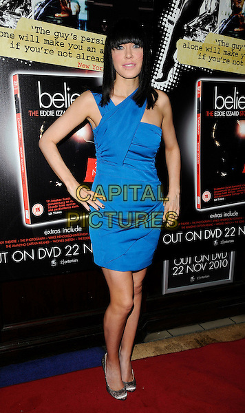 LINZI STOPPARD.Attending Eddie Izzard's DVD Premiere at Cineworld Haymarket, London, England, UK, November 18th 2010..full length blue dress one shoulder hands on hips.CAP/CAN.©Can Nguyen/Capital Pictures.