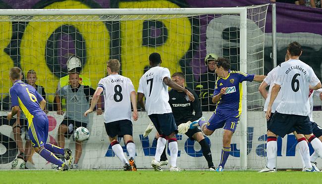 Maribor striker Etien Velikonja backheels in the winning goal past Allan McGregor