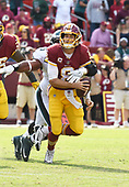 Washington Redskins quarterback Kirk Cousins (8) is in the process of being sacked by Philadelphia Eagles defensive end Brandon Graham (55) in late fourth quarter action at FedEx Field in Landover, Maryland on Sunday, September 10, 2017.  The Eagles won the game 30 - 17.<br /> Credit: Ron Sachs / CNP