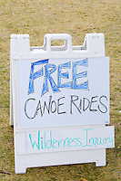 Sign advertising free canoe rides from Wilderness Inquiry outdoor adventure. Aquatennial Beach Bash Minneapolis Minnesota USA