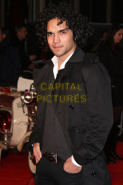 REECE RITCHIE .European Premiere of 'Brighton Rock' at the Odeon West End, Leicester Square, London, London, England, UK,.1st February 2011..half length black trench coat white shirt belt jumper sweater  .CAP/ROS.©Steve Ross/Capital Pictures