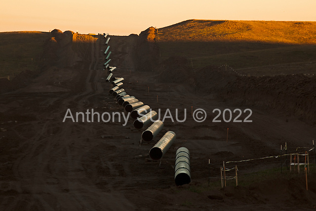 near St. Anthony, North Dakota<br /> September 26, 2016<br /> <br /> The Dakota Access Pipeline under construction, will transport light, sweet crude oil from the North Dakota Bakken region through South Dakota and Iowa into Illinois.<br /> <br /> The Standing Rock Sioux, whose tribal lands are a half-mile south of the proposed route, say the pipeline would desecrate sacred burial and prayer sites, and could leak oil into the Missouri and Cannon Ball rivers, on which the tribe relies for water.<br /> <br /> Opposition to the pipeline has drawn support from 200 Native American tribes, as well as from activists and celebrities. <br /> <br /> Energy Transfer Partners—one of the major stakeholders in the controversial Dakota Access pipeline—bought over 6,000 acres of land surrounding the line's route in North Dakota, according to several media reports over the weekend.