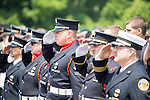 Kentucky State Trooper Eric Keith Chrisman was laid to rest Monday June 29, 2015 in Lawrenceburg, Ky.  He died in the the line of duty June 23, 2015.  Police officers and Fire fighters from across Kentucky and the Nation came to pay respects to his family.  Photo by Mark Mahan