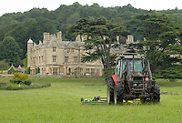 Dumbleton Estates topping parkland grass in front of Dumbleton Hall, Dumbleton, Evesham, Worcestershire which is grazed by the farms' beef herd and sheep flock.