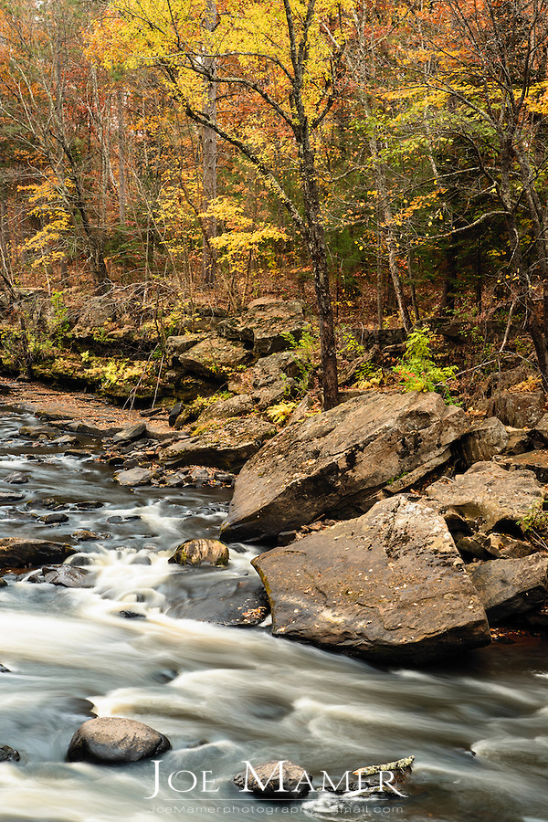 The Kettle River flowing through Banning State Park in Autumn...Banning State Park stretches along 10 miles (16 km) of the Kettle River near Sandstone in Pine County. The centerpiece of the park is 1.5 miles (2.4 km) of churning rapids, some up to Class IV.