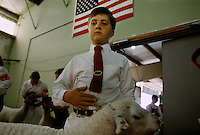 Jake Guyha with his lamb during a judging at the Curry County Fair in Gold Beach, Oregon.
