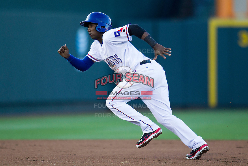 Round Rock Express shortstop Jurickson Profar #10 runs to third base against the Omaha Storm Chasers in the Pacific Coast League baseball game on April 4, 2013 at the Dell Diamond in Round Rock, Texas. Round Rock defeated Omaha in their season opener 3-1. (Andrew Woolley/Four Seam Images).