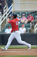 Alex Destino (23) of the Piedmont Boll Weevils follows through on his swing against the Greensboro Grasshoppers at Kannapolis Intimidators Stadium on June 16, 2019 in Kannapolis, North Carolina. The Grasshoppers defeated the Boll Weevils 5-2. (Brian Westerholt/Four Seam Images)