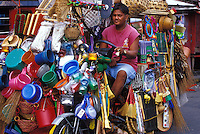 Housewares salesman on motorbike well burdened with goods, Manila, Philippines