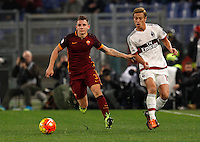 Calcio, Serie A: Roma vs Milan. Roma, stadio Olimpico, 9 gennaio 2016.<br /> Roma's Lucas Digne, left, is chased by AC Milan's Keisuke Honda during the Italian Serie A football match between Roma and Milan at Rome's Olympic stadium, 9 January 2016.<br /> UPDATE IMAGES PRESS/Riccardo De Luca