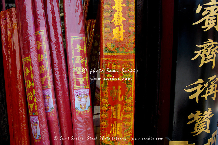 Brightly colored packs of incense sold near a monastery, Datong, Shanxi, China.
