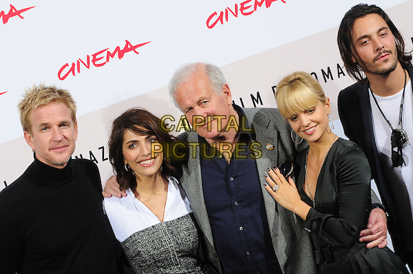 "MATTHEW MODINE, CATERINA MURINO, JOHN IRVIN, MENA SUVARI & JACK HUSTON.Photocall for ""The Garden of Eden"" during the Rome International Film Festival, Rome, Italy..October 26th, 2008.half length black top shirt grey gray strapless .CAP/CAV.©Luca Cavallari/Capital Pictures."