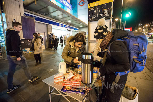 """London, 14/01/2016. This evening, members of the public supported by """"Street Kitchens"""" - a non-profit organisation that provides information and help for homeless people - met outside Brixton Station for """"distributing and collecting essential items to those who may need them on our streets"""". Wool hats, gloves, jumpers, trousers, shoes, tooth paste and brushes, coats, and then cups of tea and hot soups, sandwiches, water, biscuits and a lot of company and smiles were donated this evening to the homeless people who are experiencing the London's cold winter. <br /> <br /> For more information please click here: http://www.streetskitchen.co.uk & http://on.fb.me/1T3sCCt & http://on.fb.me/1YmT4bE & http://on.fb.me/1YmT8Iu<br /> <br /> EDIT - 11 APRIL 2016 - Following my return from Calais and Dunkirk camps in April 2016, news came to light of an ongoing court case that one of the people featured in these photo stories is involved in as a defendant. I had not known about this previously, and neither had Zekra, who is the organiser of """"Happy Ravers"""" - one of the groups featured in these photostories. <br /> These photostories do show great work being done to help homeless people, and I will continue documenting this project. Though it is the job of the courts to reach a verdict (I do believe people are innocent until proven guilty), I have none the less decided that moving forward I will focus only on Zekra's work."""