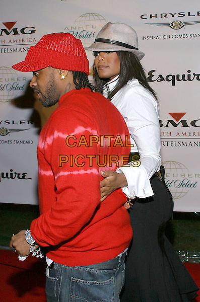 JERMAINE DUPRI & JANET JACKSON.Clive Davis Hosts A Celebration Of The American Music Awards held at The Esquire House. .14 November 2004.half length, red top, hat, arm around waist, fedora.www.capitalpictures.com.sales@capitalpictures.com.© Capital Pictures.