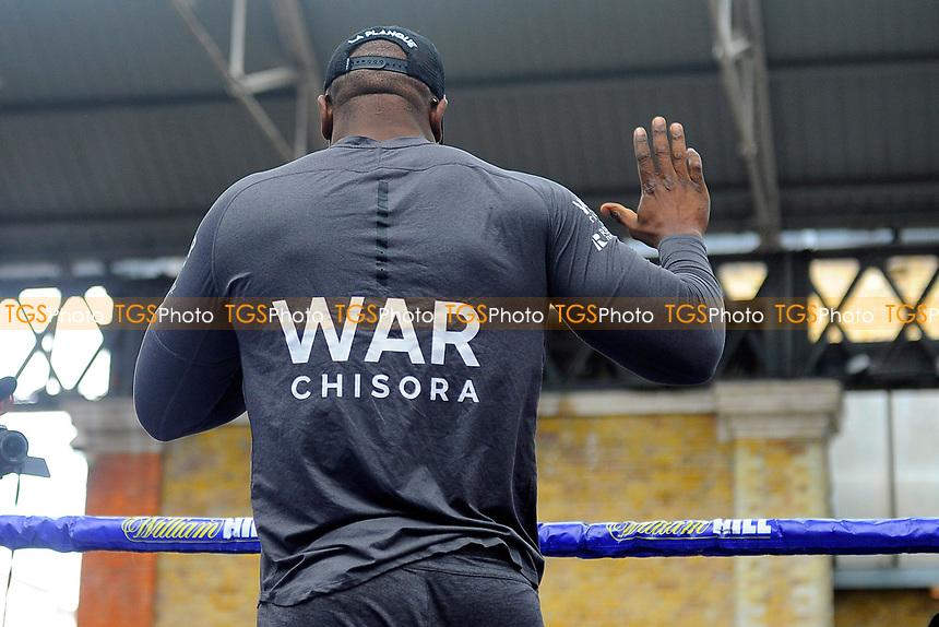 Dereck Chisora gives away £500 to a lucky fan during a Public Workout at Old Spitalfields Market on 12th April 2019
