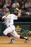 Texas A&M Aggie catcher Troy Stein #6 follows through on his swing against the Houston Cougars in the NCAA baseball game on March 1st, 2013 at Minute Maid Park in Houston, Texas. Houston defeated Texas A&M 7-6. (Andrew Woolley/Four Seam Images).