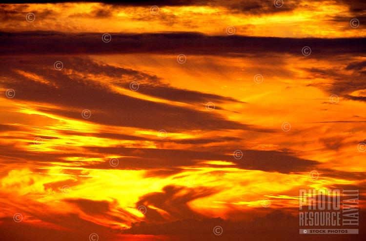 Beautiful yellow orange sky at sunset in Hawaii