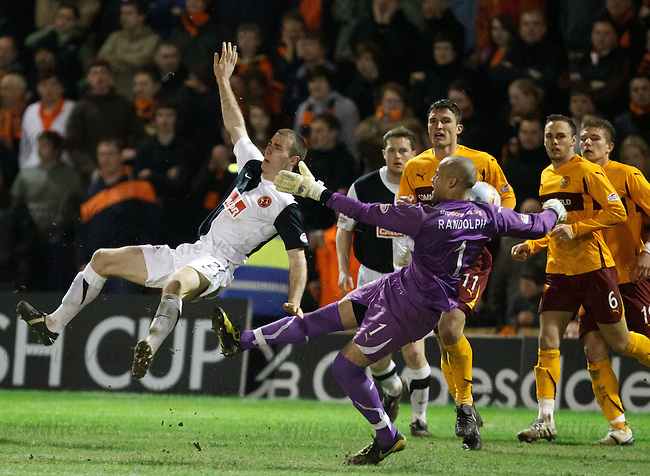 Shaun Dillon gets a right good boot up the arse from keeper Darren Randolph as the Unted man encroaches on a goal-kick