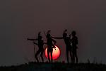 Botswana, Africa , Makgadikgadi Pans National Park, San tribesmen at sunset