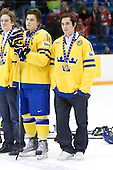 (Erixon) Anton Lander (Sweden - 16), Marcus Johansson (Sweden - 11) - Team Sweden celebrates after defeating Team Switzerland 11-4 to win the bronze medal in the 2010 World Juniors tournament on Tuesday, January 5, 2010, at the Credit Union Centre in Saskatoon, Saskatchewan.