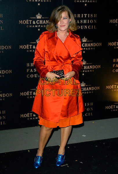 TRACEY BOYD.The Moet & Chandon Champagne Mirage party, Opera Holland Park, London, England..September 16th, 2007.full length blue metallic shoes red satin trench coat mac jacket clutch purse .CAP/CAN.©Can Nguyen/Capital Pictures