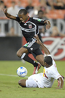 US Open Cup Quarterfinal, United forward Jamil Walker (23) being tackled by Red Bulls defender Marvell Wynne (2) during the game. DC United defeated the New York Red Bulls 3-1, Wednesday, August 23, 2006 at RFK Stadium.