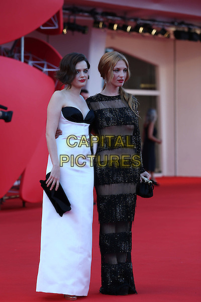Josephine De La Baume & Roxane Mesquida.'The Company You Keep' Premiere during The 69th Venice Film Festival at the Palazzo del Cinema, Venice, Italy..September 6th, 2012.full length black white  strapless dress stripe sheer clutch bag .CAP/IPP/GR.©Gianluca Rona/IPP/Capital Pictures.