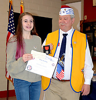Janelle Jessen/Herald-Leader<br /> Frank Lee, commander of Veterans of Foreign Wars Post 1674, right, presented Genevieve Crafton with the second place award and a $75 prize for the Patriots Pen essay contest on Feb. 12. The topic of the essay contest was &quot;Why I Honor the American Flag.&quot;