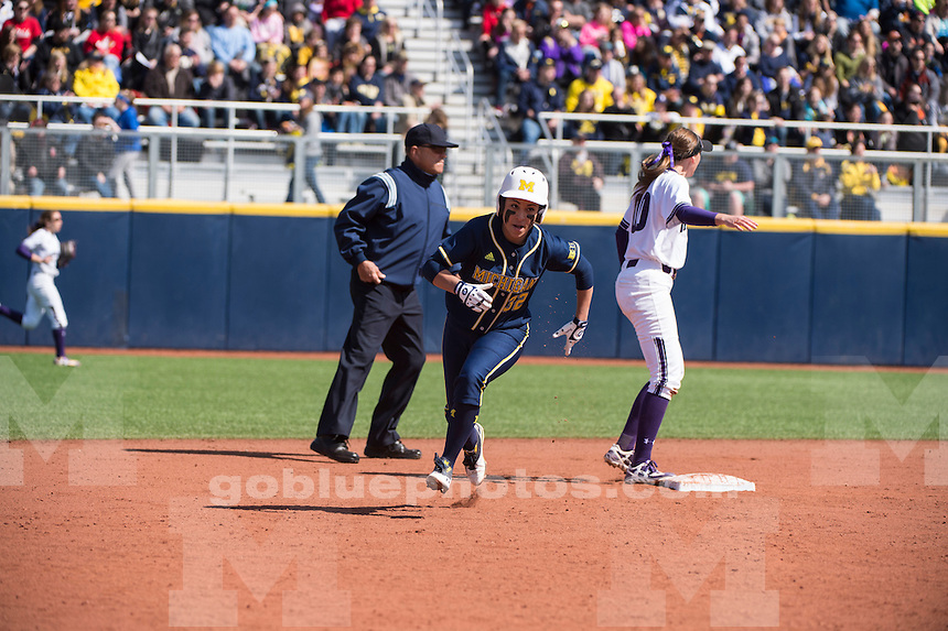 The University of Michigan softball team beats Northwestern, 11-3, in five innings at Alumni Field in Ann Arbor on March 26, 2015.