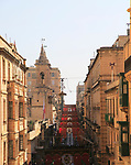Flags decorate historic street in city centre of Valletta, Malta