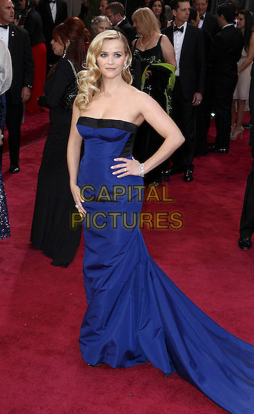 Reese Witherspoon (wearing Louis Vuitton).85th Annual Academy Awards held at the Dolby Theatre at Hollywood & Highland Center, Hollywood, California, USA..February 24th, 2013.oscars full length dress hand on hip black strapless  cobalt blue.CAP/ADM/SLP/COL.©Colin/StarlitePics/AdMedia/Capital Pictures