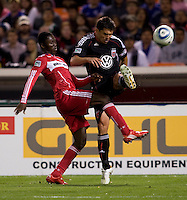 Patrick Nyarko (14) of the Chicago Fire collides with Jaime Moreno (99) of DC United at RFK Stadium in Washington, DC.  The Chicago Fire defeated DC United, 2-0.