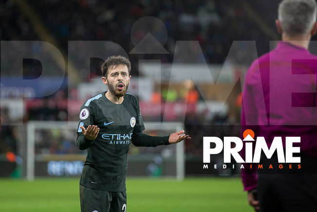 Bernardo Silva of Manchester City questions the referee's assistant after a foul throw is given against him during the EPL - Premier League match between Swansea City and Manchester City at the Liberty Stadium, Swansea, Wales on 13 December 2017. Photo by Mark  Hawkins / PRiME Media Images.