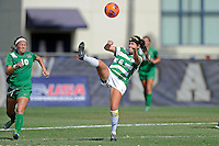 8 November 2015:  North Texas Defender Molly Grisham (6) attempts to control the ball as Marshall Forward Mack Moore (10) approaches in the first half as the University of North Texas Mean Green defeated the Marshall University Thundering Herd, 1-0, in the Conference USA championship game at University Park Stadium in Miami, Florida.
