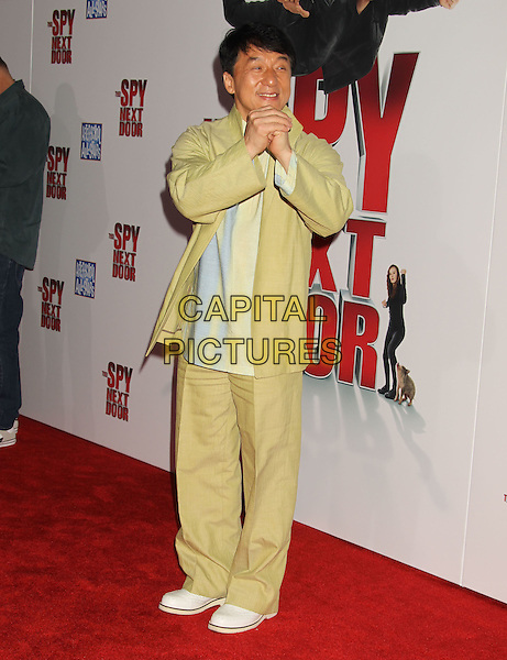 """JACKIE CHAN.""""The Spy Next Door"""" Los Angeles Premiere held at The Grove, Los Angeles, California, USA, .January 9th, 2010. .full length shirt jacket hands fists pose gesture trousers suit green yellow white shoes .CAP/ADM/MJ.©Michael Jade/AdMedia/Capital Pictures."""