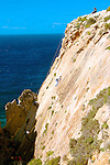 Rock climbing and abseiling on cliffs near Ghar Lapsi on Malta. Rock climbing is a popular sport in Malta given the 300 days of sunshine and steep westerly cliffs.