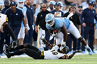 CHAPEL HILL, NC - SEPTEMBER 21: Carl Tucker #86 of the University of North Carolina avoids an attempted tackle by Milan Tucker #18 of Appalachian State University during a game between Appalachian State University and University of North Carolina at Kenan Memorial Stadium on September 21, 2019 in Chapel Hill, North Carolina.
