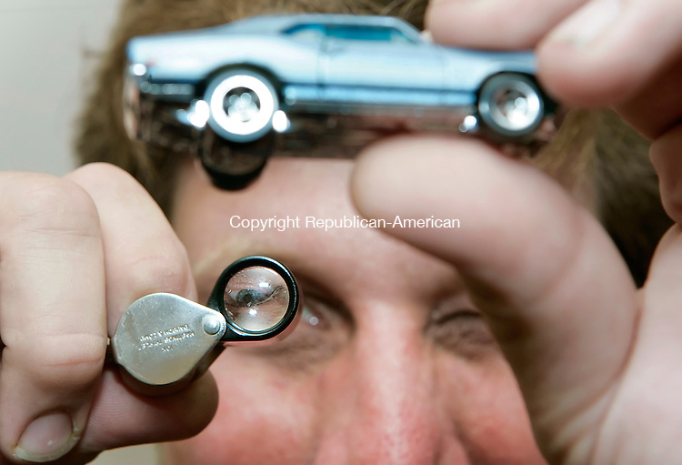 WATERBURY, CT - 30 JULY 2005 -073005JT09--<br /> Jim Dietlin, 34, of Winsted, looks at a Hot Wheels Chevy Nova through a jeweler's loupe at the &quot;Wicked Weekend of Hot Wheels 2005&quot; at the Connecticut Grand Hotel and Conference Center Saturday. Dietlin favors the Hot Wheels model because he has a real-life version of it at his house.<br /> --Josalee Thrift Photo--