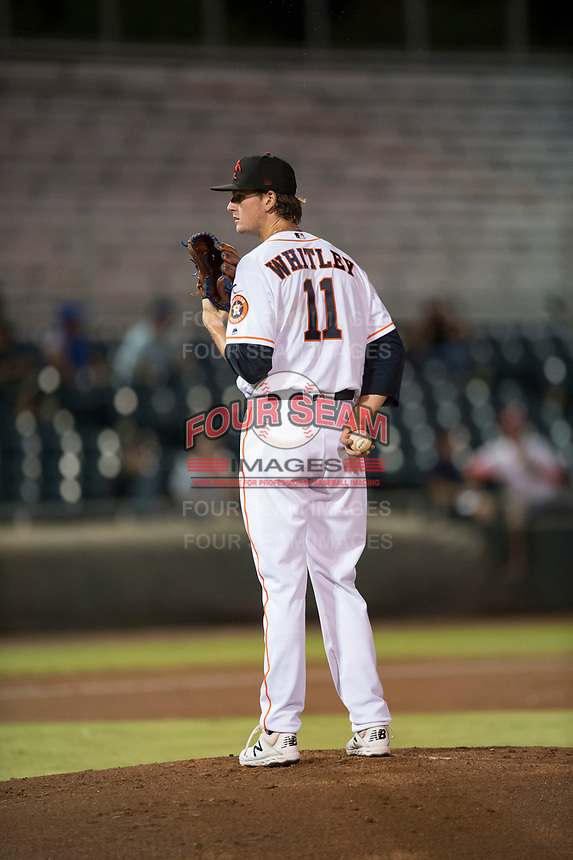 Scottsdale Scorpions starting pitcher Forrest Whitley (11), of the Houston Astros organization, looks in for the sign during an Arizona Fall League game against the Mesa Solar Sox on October 9, 2018 at Scottsdale Stadium in Scottsdale, Arizona. The Solar Sox defeated the Scorpions 4-3. (Zachary Lucy/Four Seam Images)
