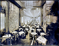 BNPS.co.uk (01202 558833)<br /> Pic:    CanterburyAuctionGalleries/BNPS<br /> <br /> The First Class dining room, longer than the Hall of Mirrors at Versailles and able to seat 700.<br /> <br /> It was illuminated by Lalique glass lighting and decorated with gilded bronze wall panels by Louis Dejean.<br /> <br /> Remarkable photos of the iconic ocean liner SS Normandie which was like a 'floating palace' have come to light over 80 years later.<br /> <br /> The giant 1,000ft long French passenger ship was the largest of her type in the world and won the coveted 'Blue Riband' for the fastest crossing of the Atlantic.<br /> <br /> English photographer Percy Byron's photos show the liner's luxurious 'Art Deco' interior with its chandeliers and pillars of Lalique glass.<br /> <br /> The vessel, which launched in 1935, even boasted its own swimming pool and a gym where young women can be seen doing aerobics while a man in a suit trains with a punch bag.