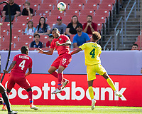 CLEVELAND, OH - JUNE 22: Eric Davis #15 heads the ball against Elliot Bonds #4 during a game between Panama and Guyana at FirstEnergy Stadium on June 22, 2019 in Cleveland, Ohio.