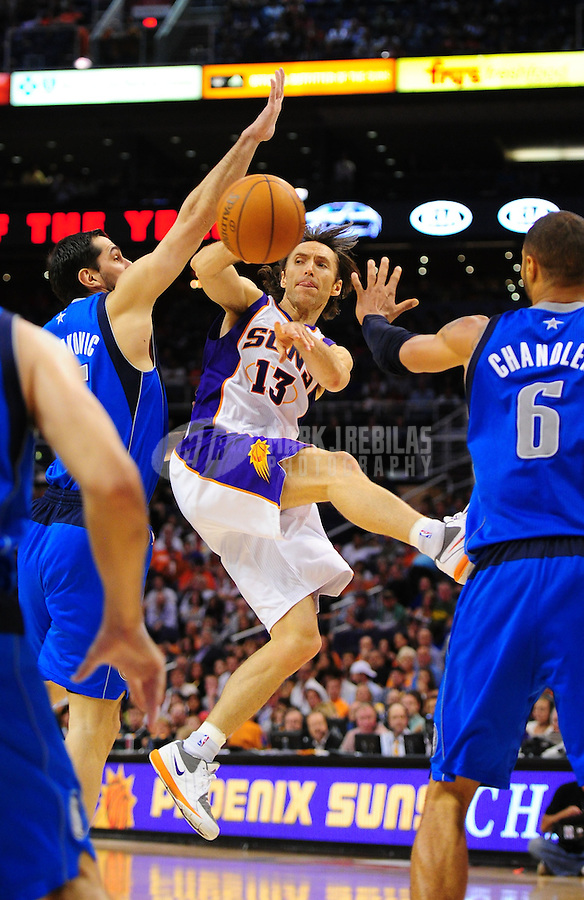 Mar. 27, 2011; Phoenix, AZ, USA; Phoenix Suns guard Steve Nash passes the ball in the second half against the Dallas Mavericks at the US Airways Center. The Maverick defeated the Suns 91-83. Mandatory Credit: Mark J. Rebilas-