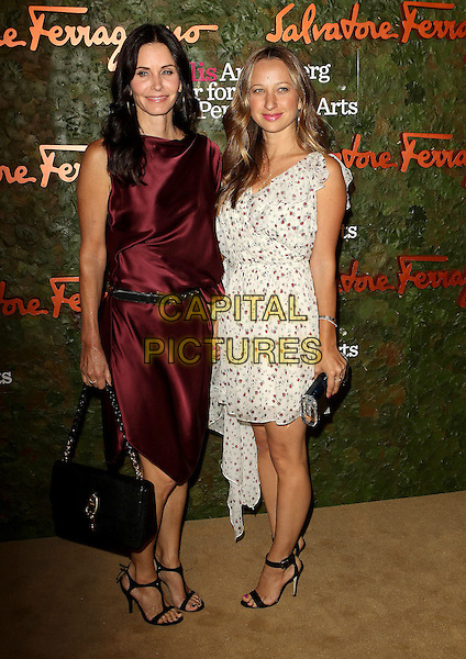 Courteney Cox, Jennifer Meyer<br /> Wallis Annenberg Center For The Performing Arts Inaugural Gala held at Wallis Annenberg Center For The Performing Arts,  Beverly Hills, California, USA, 17th October 2013.<br /> full length red silk satin dress white print black bag shoes sandals <br /> CAP/ADM/KB<br /> &copy;Kevan Brooks/AdMedia/Capital Pictures
