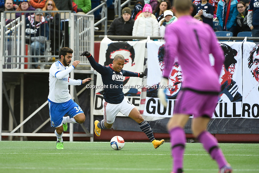 March 21, 2015 - Foxborough, Massachusetts, U.S. - New England Revolution forward Charlie Davies (9) works against Montreal Impact defender Victor Cabrera (36) to get the ball to the net during the MLS game between the Montreal Impact and the New England Revolution held at Gillette Stadium in Foxborough Massachusetts. The Revolution and the Impact ended the game tied 0-0. Eric Canha/CSM