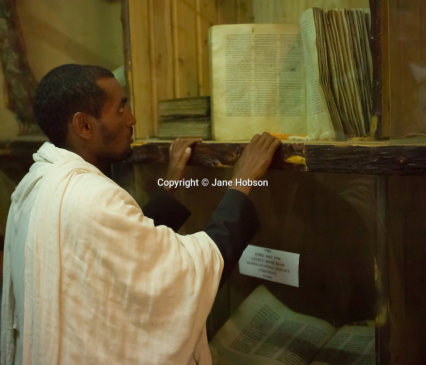 26/01/12. Gondar, Ethiopia. Kuskuam church (Qusquam Mariam) and the ruined palace of Queen Mentowab sit atop a hill above Gondar. A priest demonstrates the earliest muscial notation by singing prayers from an ancient text. Photo credit: Jane Hobson.