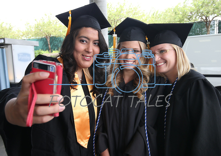 From left, Elivette Zambrano, Summer Black and Hillary Anthony take an usie before the Western Nevada College commencement at the Pony Express Pavilion, in Carson City, Nev., on Monday, May 19, 2014. A record-high 543 students graduate from WNC this week. <br /> Photo by Cathleen Allison/Nevada Photo Source