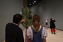 "New Zealand born, and London-based, artist, Francis Upritchard's exhibition, ""Wetwang Slack"", opens in The Curve gallery, at the Barbican Centre. The exhibition runs from 27th September 2018 to 6th January 2019. Picture shows: Visitors looking at Green Muppet Hand (2018)"